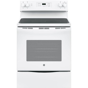 White glass top electric stove with storage drawer and display