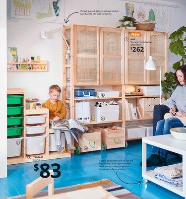 ikea 2021 catalog showing kid's playroom with vibrant blue floors