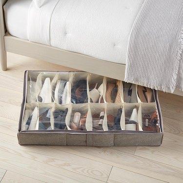 Under bed shoe organizer, bed frame, white bedding.