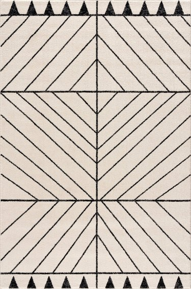 Black and white eco-friendly rug with line and triangle pattern