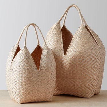 sustainable home decor with two woven baskets wiht handles