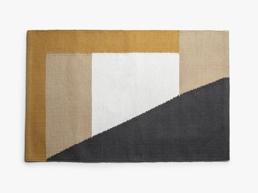 Yellow, white, and black eco-friendly rug with geometric design
