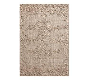 Cream eco-friendly rug with subtle geometric patterning