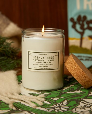 sustainable home decor with lit candle in a glass jar