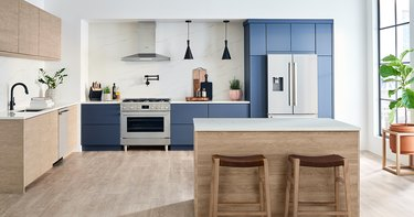 stove brand Bosch in a blue and brown kitchen with stove and kitchen island