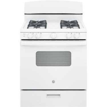White small gas stove with grates and storage drawer