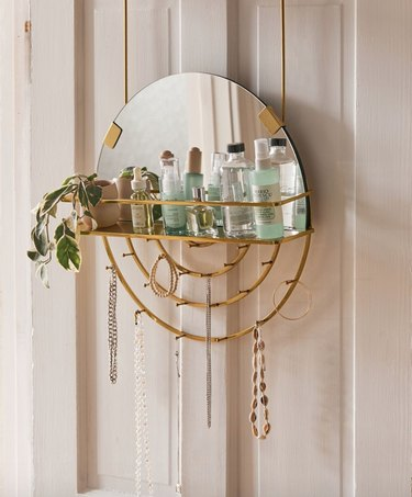 Over the Door Storage with Hanging organizer with mirror, necklaces, beauty supplies, plant.