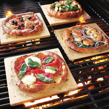 Mini pizza stones with pizzas inside oven. small stove size
