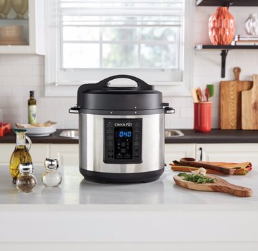 Slow cooker on kitchen counter with ingredients. small stove size ideas