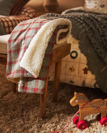 blanket on chair near toy horse