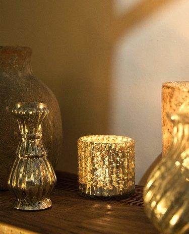 glass tealight holder near other decor items