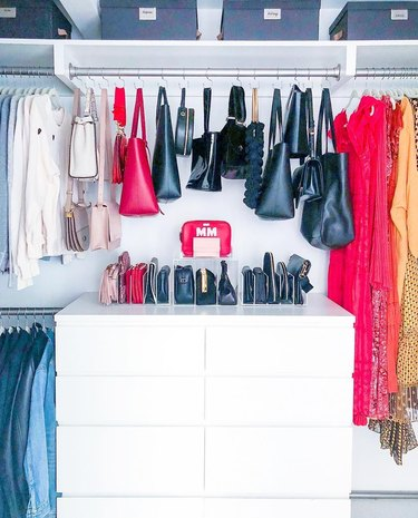 DIY Closet Organizer Ideas in organized closet with bags on purse hooks