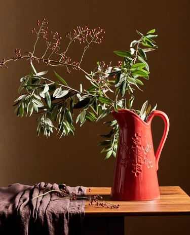 greenery in red earthenware pitcher