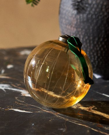 glass christmas ornament on black marble table
