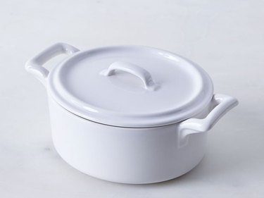 White ceramic coated cast iron cookware by Revol Porcelain France