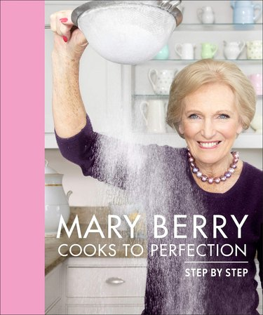 """photo of person sifting powdered sugar with title """"Mary Berry Cooks to Perfection Step by Step"""""""
