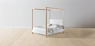 eco-friendly bed frame and upholstered headboard with canopy