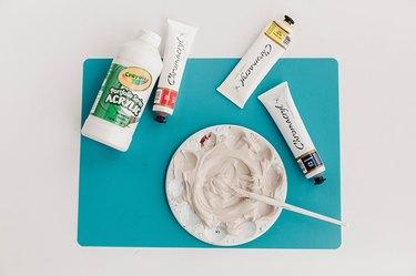 Mix acrylic paints to get your desired color for the finished diffuser.