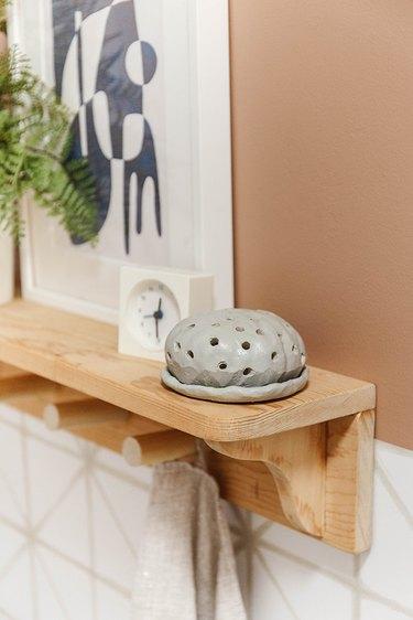 Air-dry clay diffuser on wood shelf