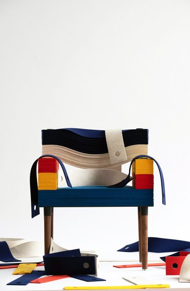 stablack felt arm chair with felt pieces on the floor