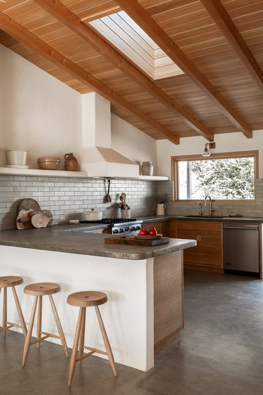 white kitchen with wooden ceiling