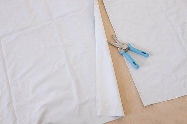 Cutting blackout fabric to size with scissors