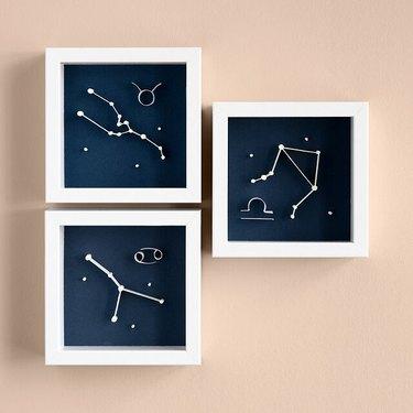Three framed Glow-in-the-Dark Zodiac Art