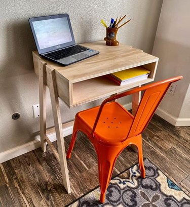 wood desk with orange chair