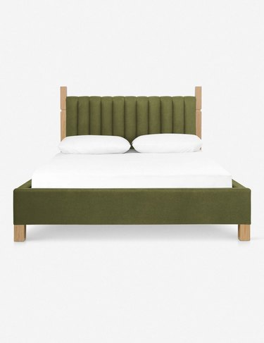 bed with green bed frame