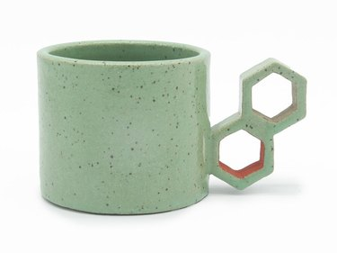 Mint-green ceramic mug with beehive inspired handle by Eunbi