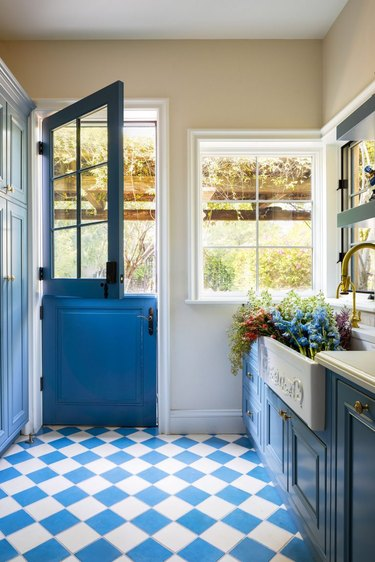 blue and white French-inspired mudroom storage