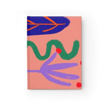 orange notebook with abstract pattern