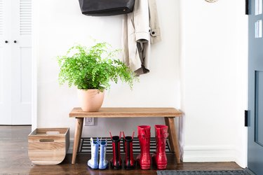 makeshift mudroom storage with bench and hooks