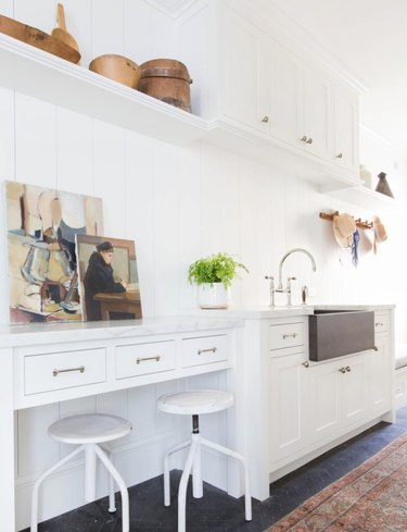 white mudroom storage with soapstone sink
