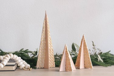 DIY balsa wood christmas trees with cane webbing and leather