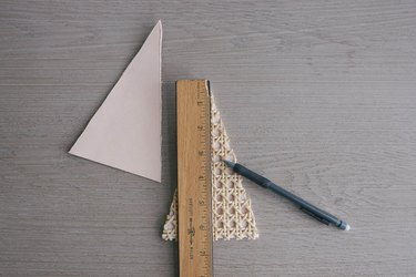 Drawing line down center of cane webbing triangle