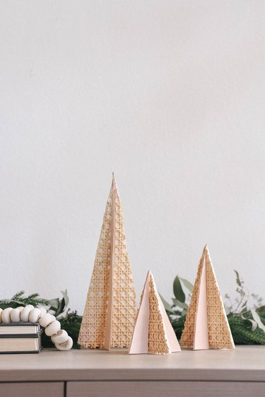 DIY mini wooden holiday trees with cane webbing and leather