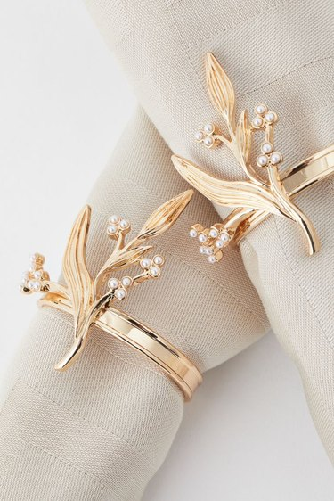 two napkins with metal napkin ring holders