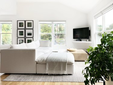 Cream colored couch in light filled living room