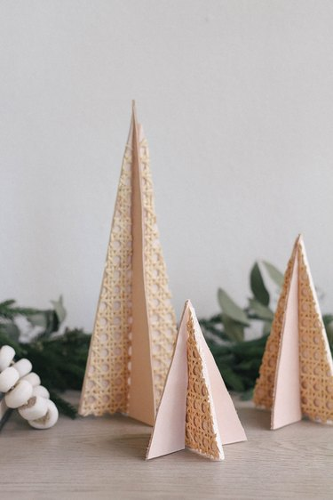 diy modern mini christmas trees made with cane webbing and leather