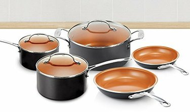 Black cookware set with copper interior