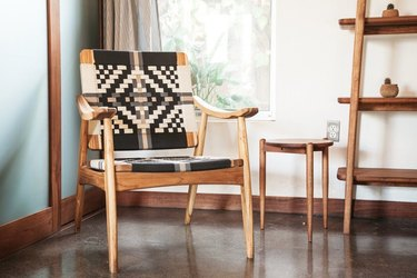 eco-friendly furniture with woven black and white wood chair with other wood furniture pieces