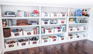 Toy storage on simple white shelves