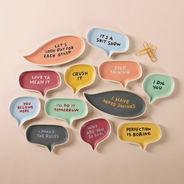 Small trays of different sizes and colors with messages