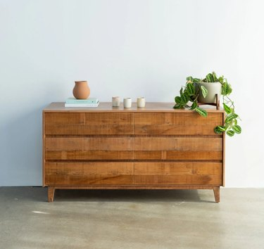 eco-friendly furniture with wood dresser with decor and houseplant