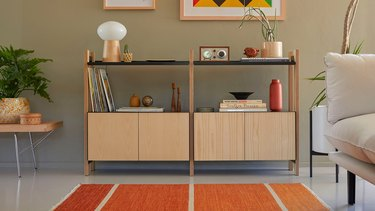 eco-friendly furniture with modern sideboard with decorative items and artwork