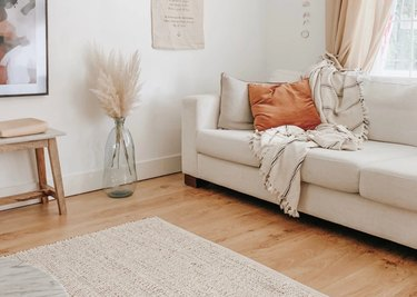 eco-friendly furniture in contemporary living room with white sofa and pampas grass