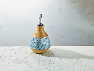 yellow and white and blue pattern olive oil dispenser