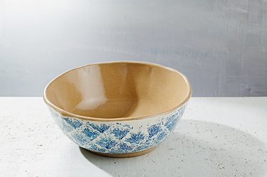 white and blue patterned serving bowl