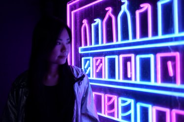 Sharmaine Kwan next to her neon artwork